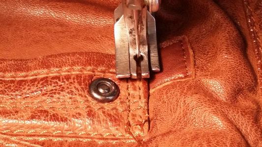 surpiquer poche blouson cuir