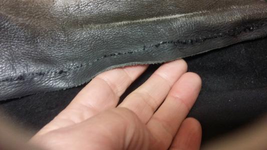 mauvaise qualité de couture sur cuir